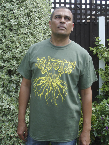Roots T-Shirt, yellow print on military green 100% cotton shirt. Big shout out to Selekta Gold from Reality Souljahs for the shots and product endorsement.\\n\\n17/07/2014 10:06