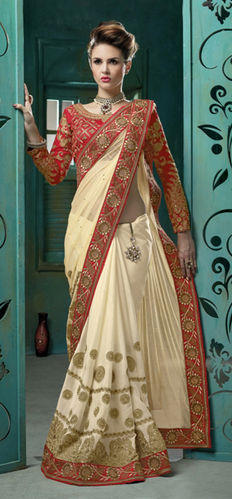Cream Chiffon And Net Embroidered Saree