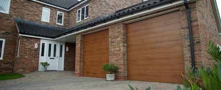 Gliderol Tuscan sectional doosr finished in golden oak fitted to a double garage