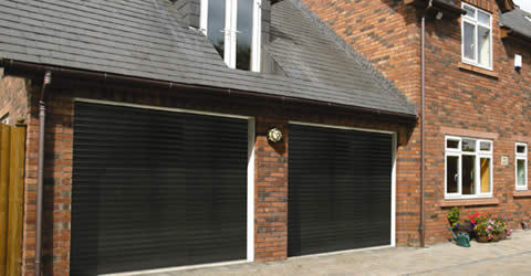 2 x Insulated roller shutter garage doors fitted to a garage with a bedroom located above