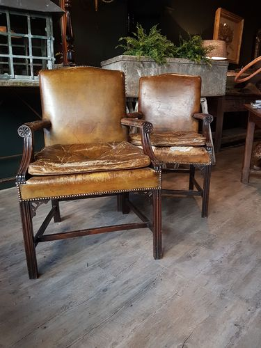 Pair English green leather library chairs