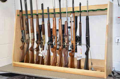 Solid Ash Gun Racks (Designed to hold virtually any type of Rifle).